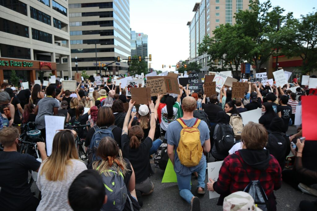 Protestors take a knee while protesting for the Black Lives Matter movement.