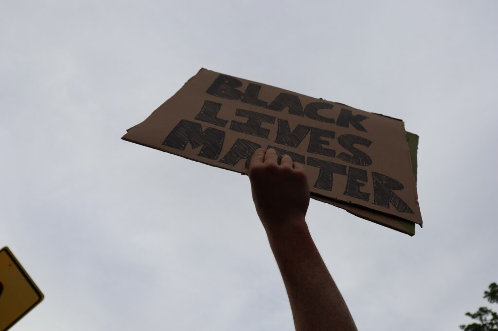 "A ""Black Lives Matter"" sign is held up proudly in protest against the recent cases of police brutality."