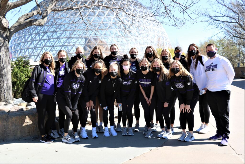 Weber's volleyball team group together for a quick photo during their time in Omaha, Nebraska for the NCAA Women's Volleyball Tournament.