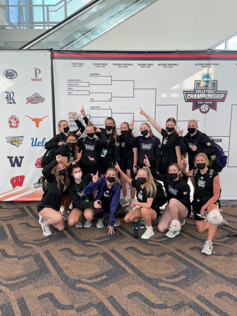 The lady wildcats point to their top position in the NCAA Women's Volleyball bracket. (Weber State Athletics)