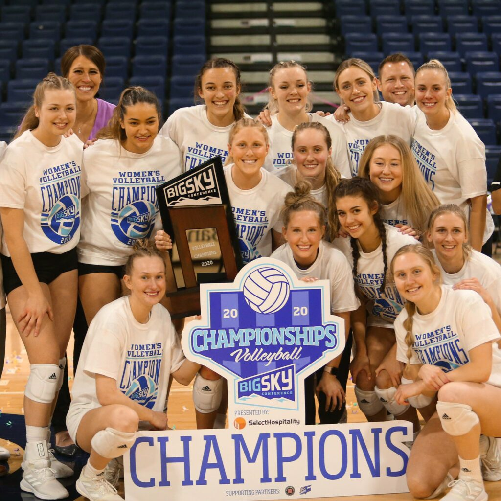 The Wildcats volleyball team poses with the Big Sky Tournament Trophy and Banner in Greeley Colorado on April 2.