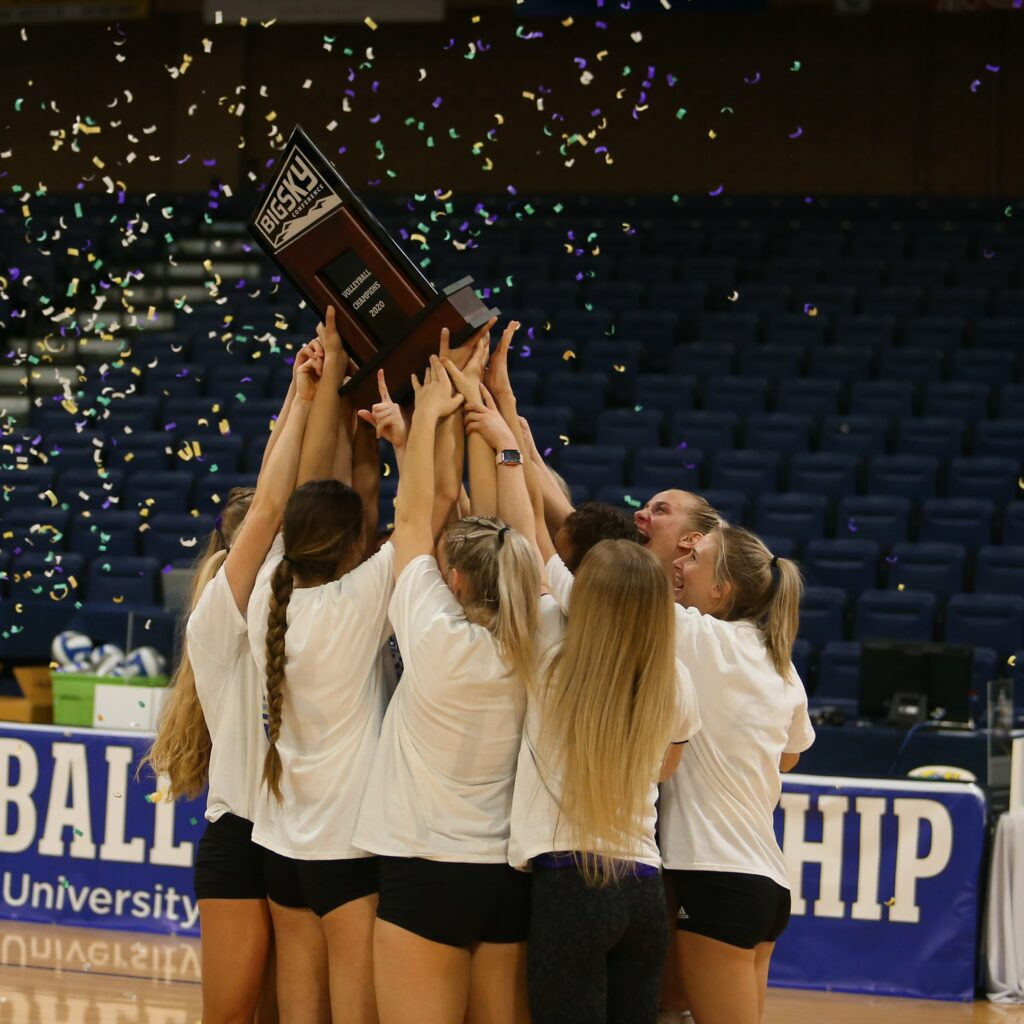 The Wildcats volleyball team hoists up the Big Sky Tournament Championship Trophy in Greeley Colorado on April 2.