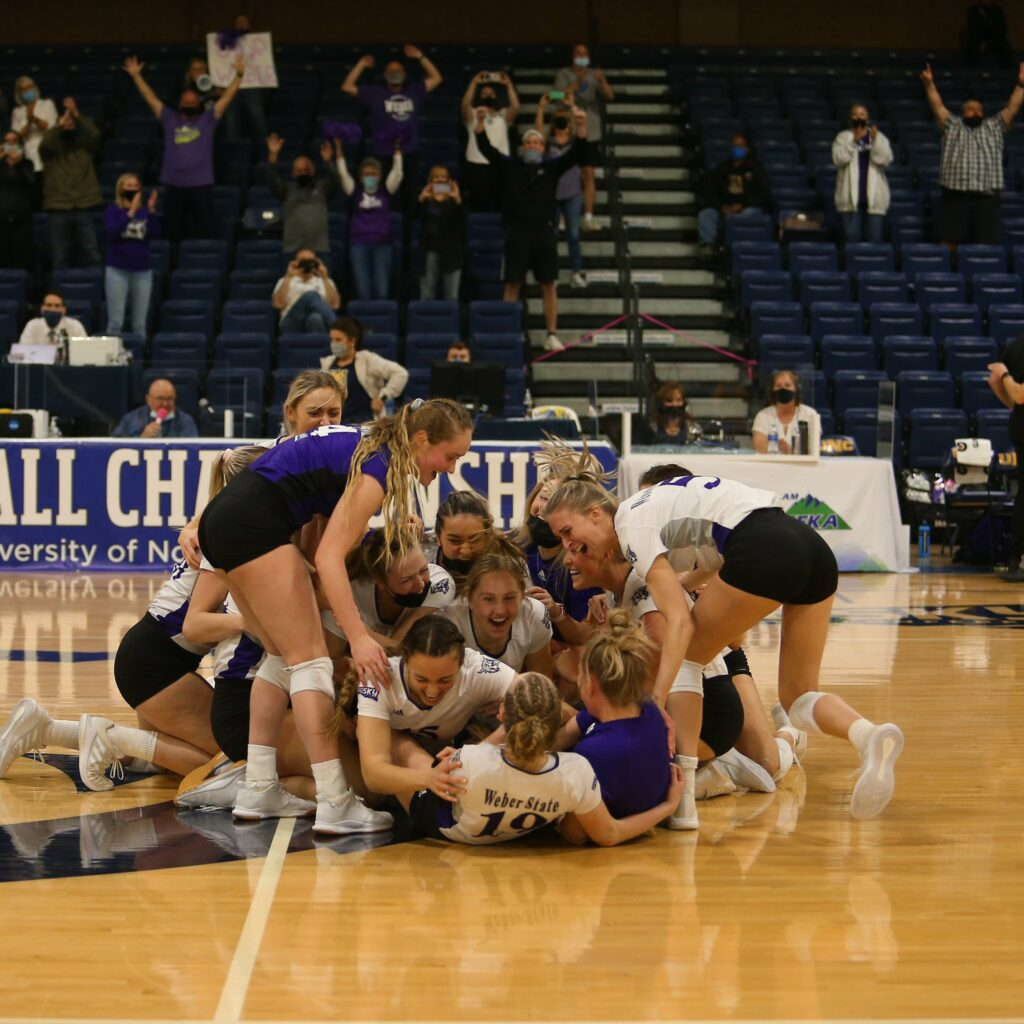 The Wildcats volleyball team celebrates their championship win in Greeley, Colorado on April 2.