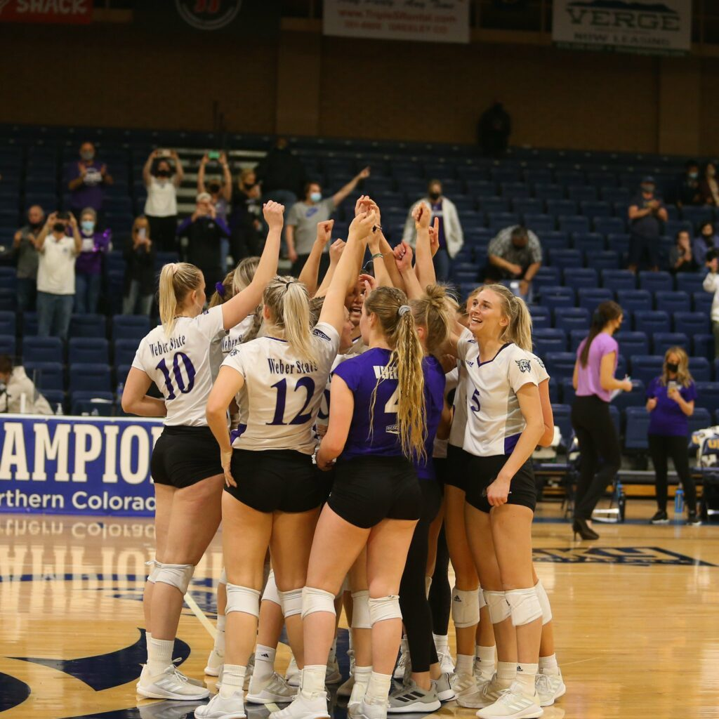 WSU's volleyball team huddles in celebration of the Tournament Championship victory in Greeley Colorado on April 2.