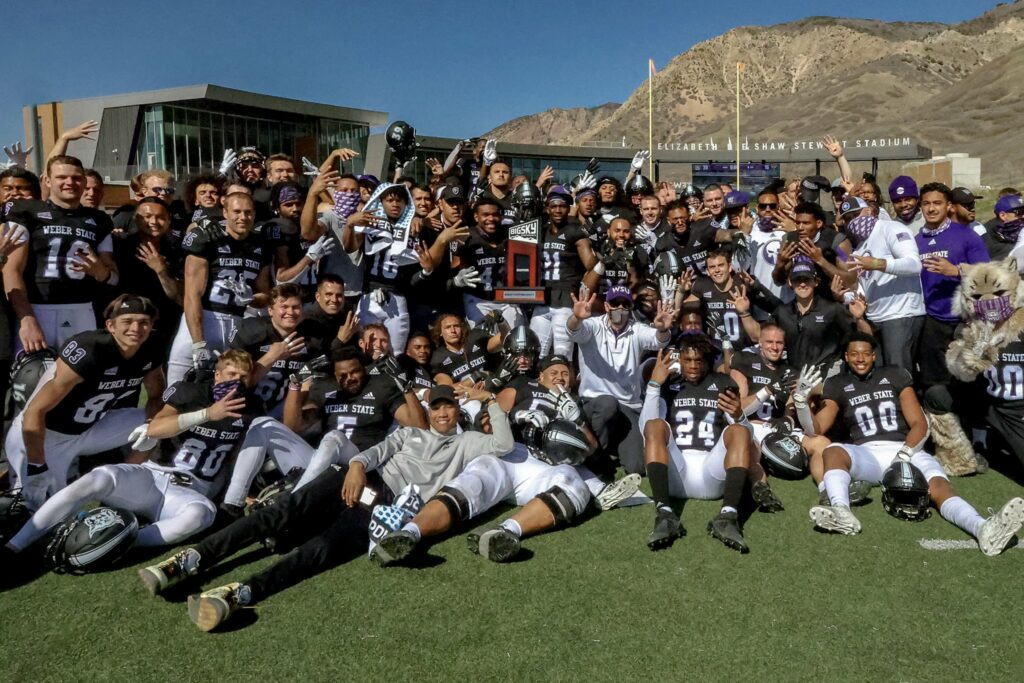 Weber State University gathers for a photo in celebration of their win over Idaho State. (WSU Athletics)