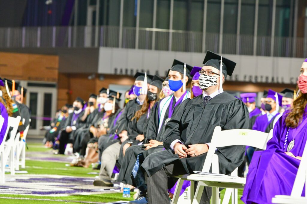 Students occupy socially distanced seats during the graduation commencement.  (Nikki Dorber / The Signpost)