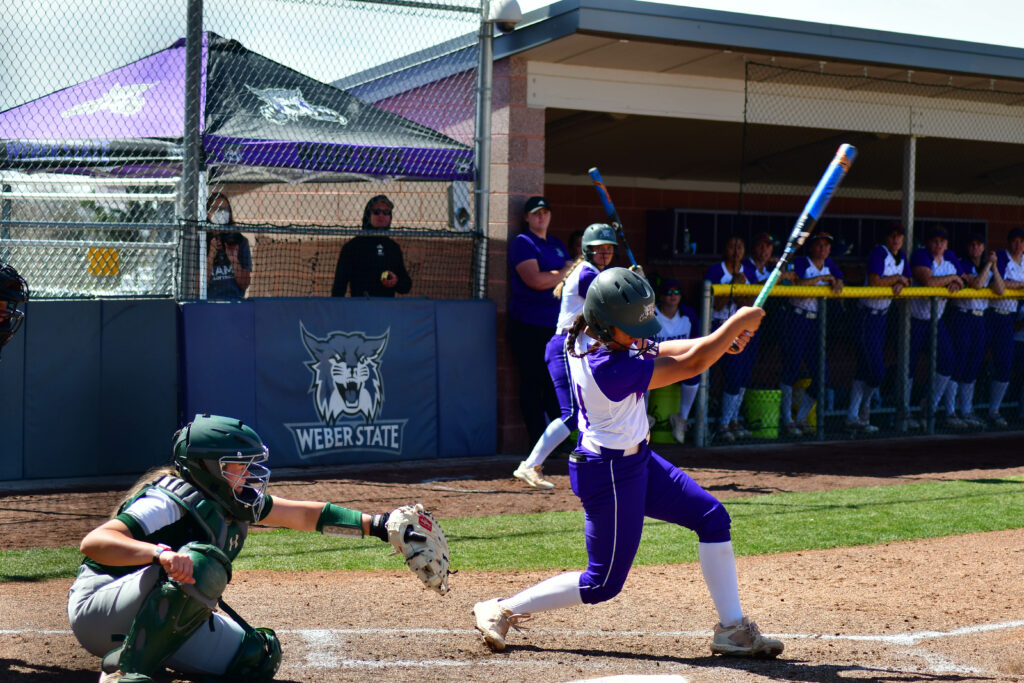 Weber State's softball player, Lauren Hoe hits the ball in the game against Colorado State on April 3 in Ogden. (Nikki Dorber/The Signpost)