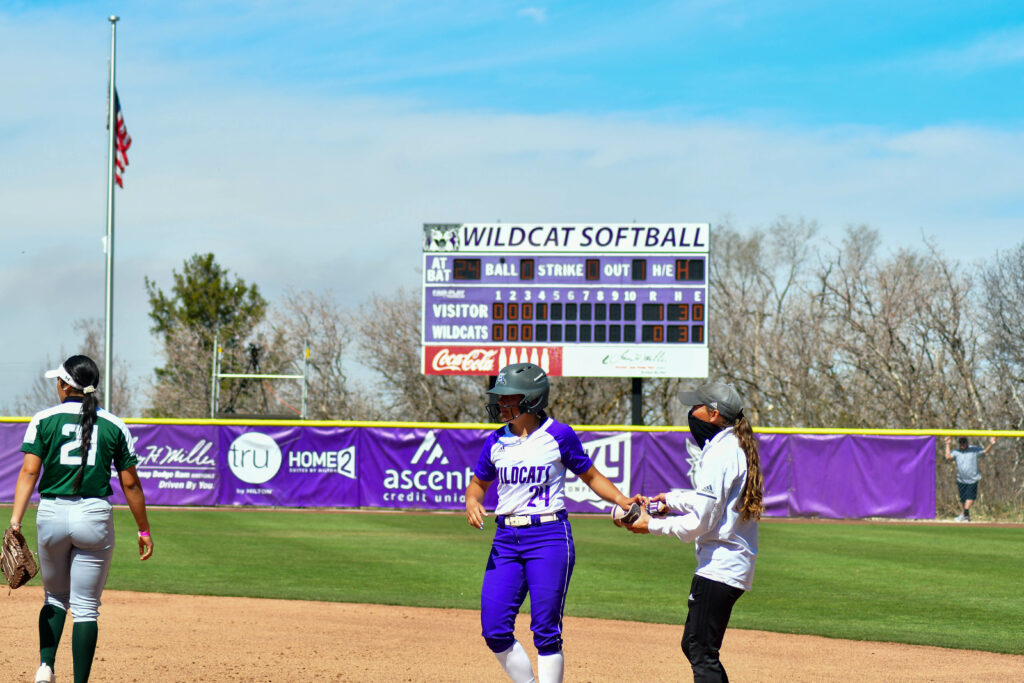 Weber State's Lauren Hoe, 24, advances to first base in their game on April 3 against Colorado State. WSU won the first of the two games played while Colorado State grabbed the second win. (Nikki Dorber/The Signpost)