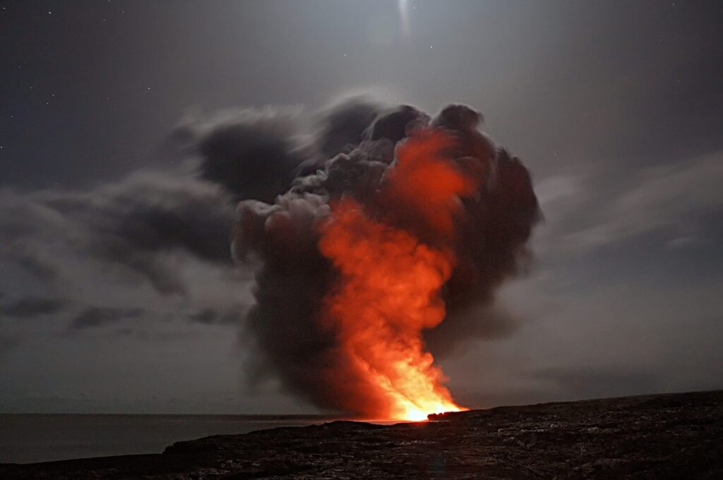 An active volcano erupting with smoke and hot lava. Image from Pixabay