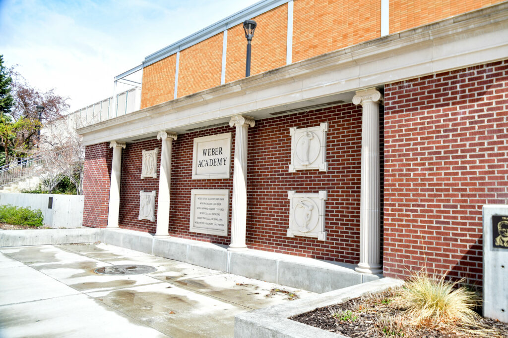 A rich history of education is recognized on the Weber Academy Wall near the Stewart Library. (Nikki Dorber/The Signpost)