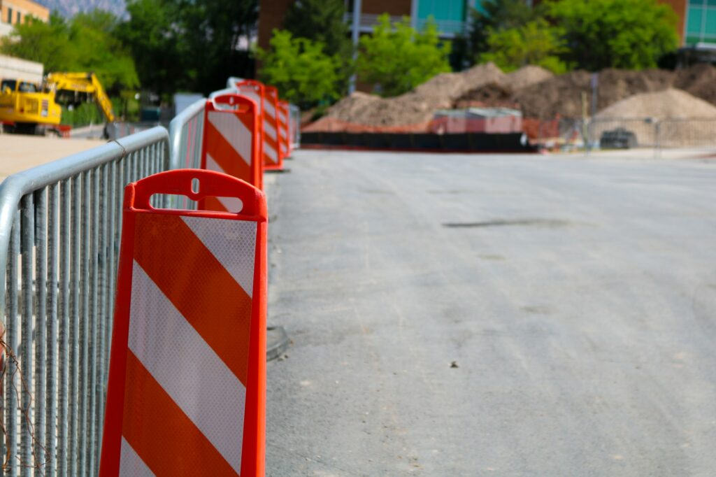 Cones line a gate separating the construction from the paid lot. (Bella Torres / The Signpost)