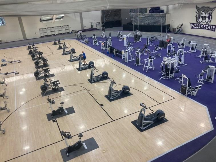 Exercise machines set up on a basketball court in Swenson Gym at the Stromberg Complex.