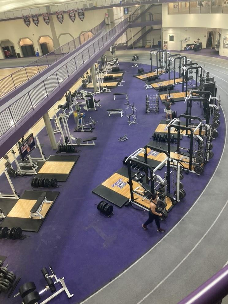 Weber State students using weight lifting equipment in Swenson Gym.