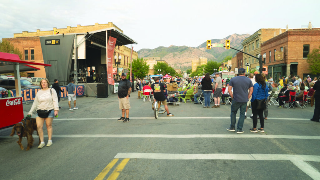 Crowds gather in the streets of downtown Ogden as the band prepares to play.  (Lisa Rajigah/The Signpost)