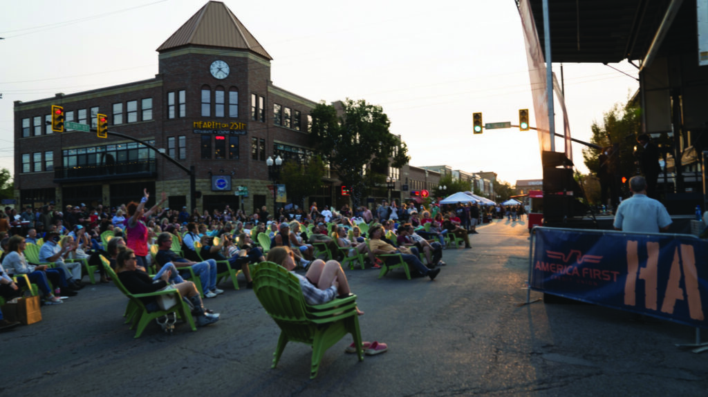 People gather in the street and listen as a band performs their Beatles Tribute (Lisa Rajigah/The Signpost)