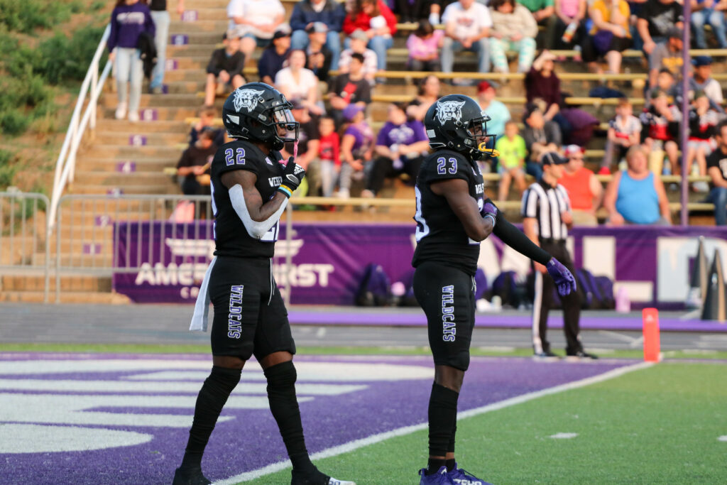 Weber State's Rashid Shaheed, 22, and Jalon Rock, 23, prepare for kickoff against James Madison. (Bella Torres / The Signpost)