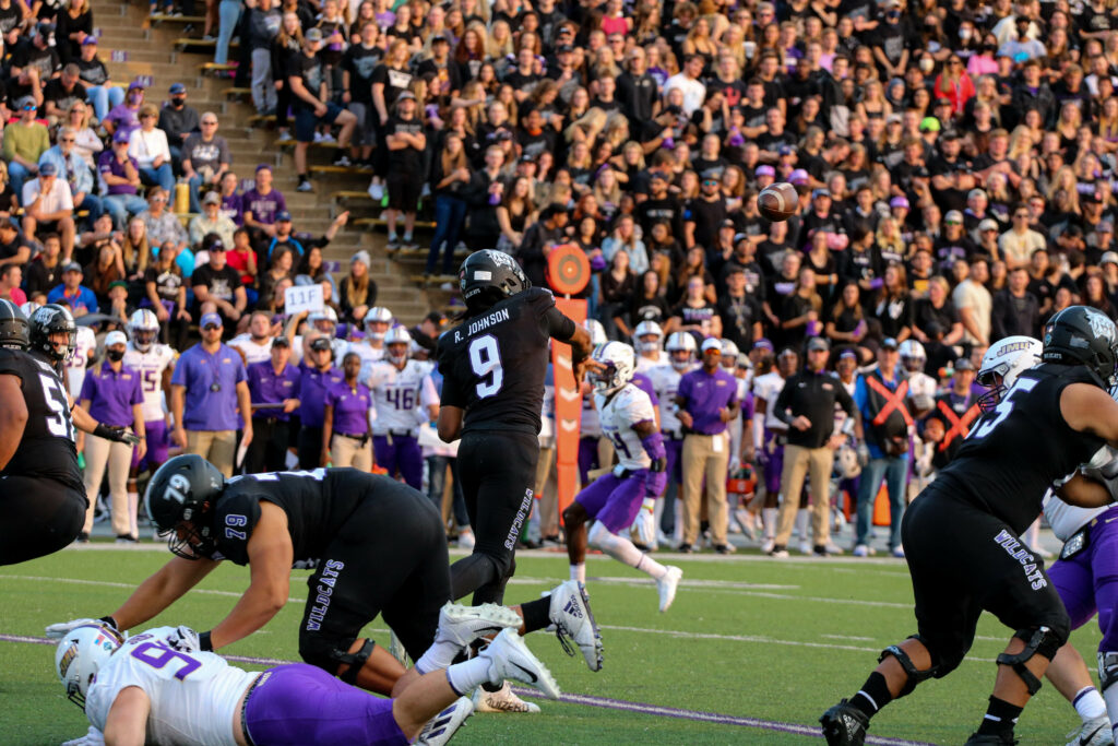 Randall Johnson, 9, throws a pass down the line in hopes of completion against James Madison University. (Bella Torres / The Signpost)