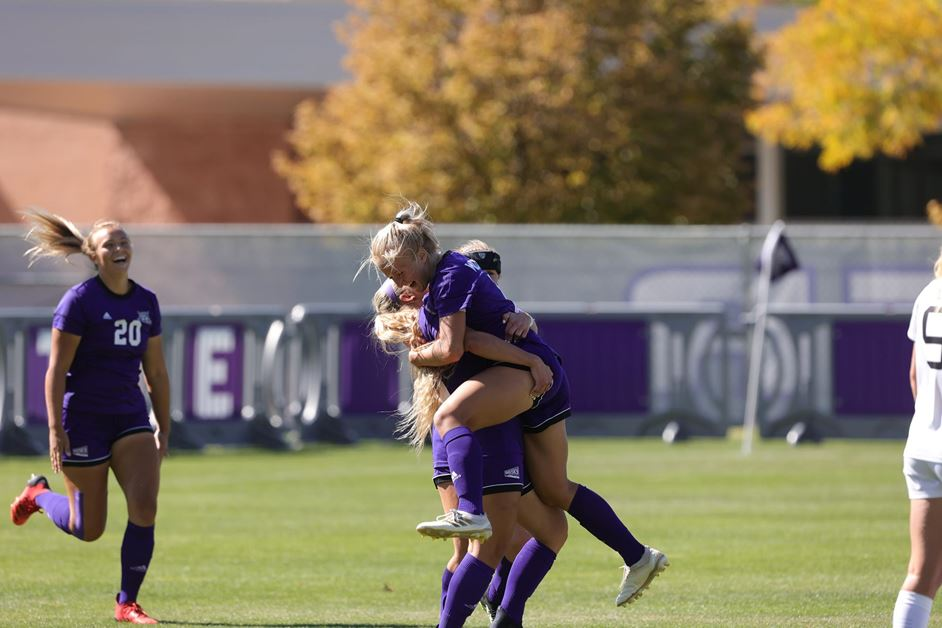Weber State's soccer team celebrates a scored goal against Idaho State at Wildcat Softball field on Oct. 3, in Ogden.