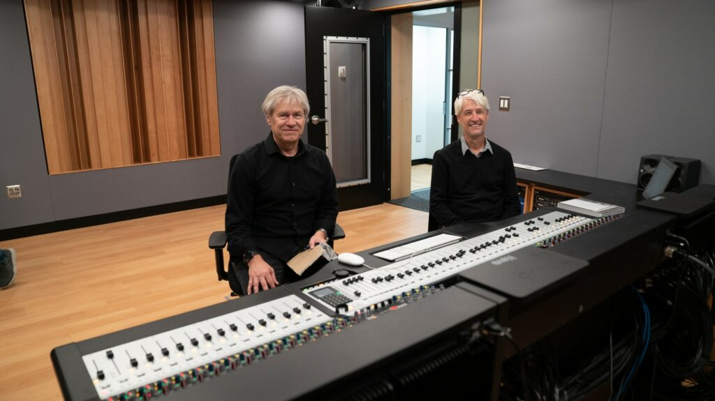 Peter Gruninsen, recording studio designer, and Shane Sanders, senior architect, enjoy the completed project of the new recording studio. (Lisa Raigah/The Signpost)
